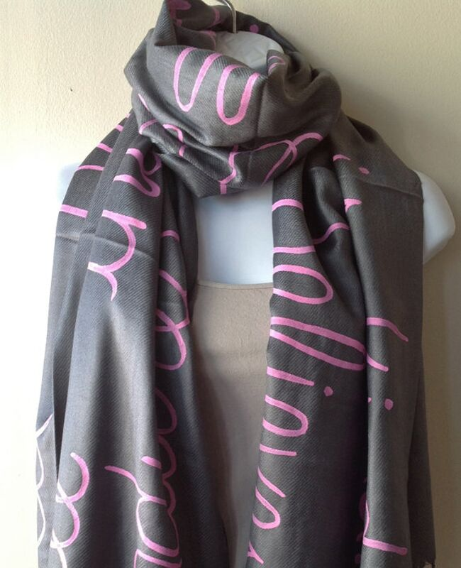 gray scarf with pink text