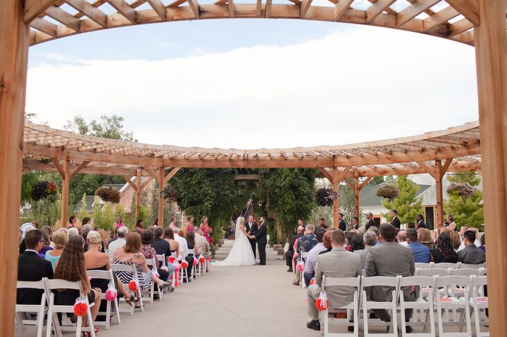 """The ceremony site outside is landscaped beautifully and covered in luscious flowers, trees, shrubs and vines,"" Nikki says."