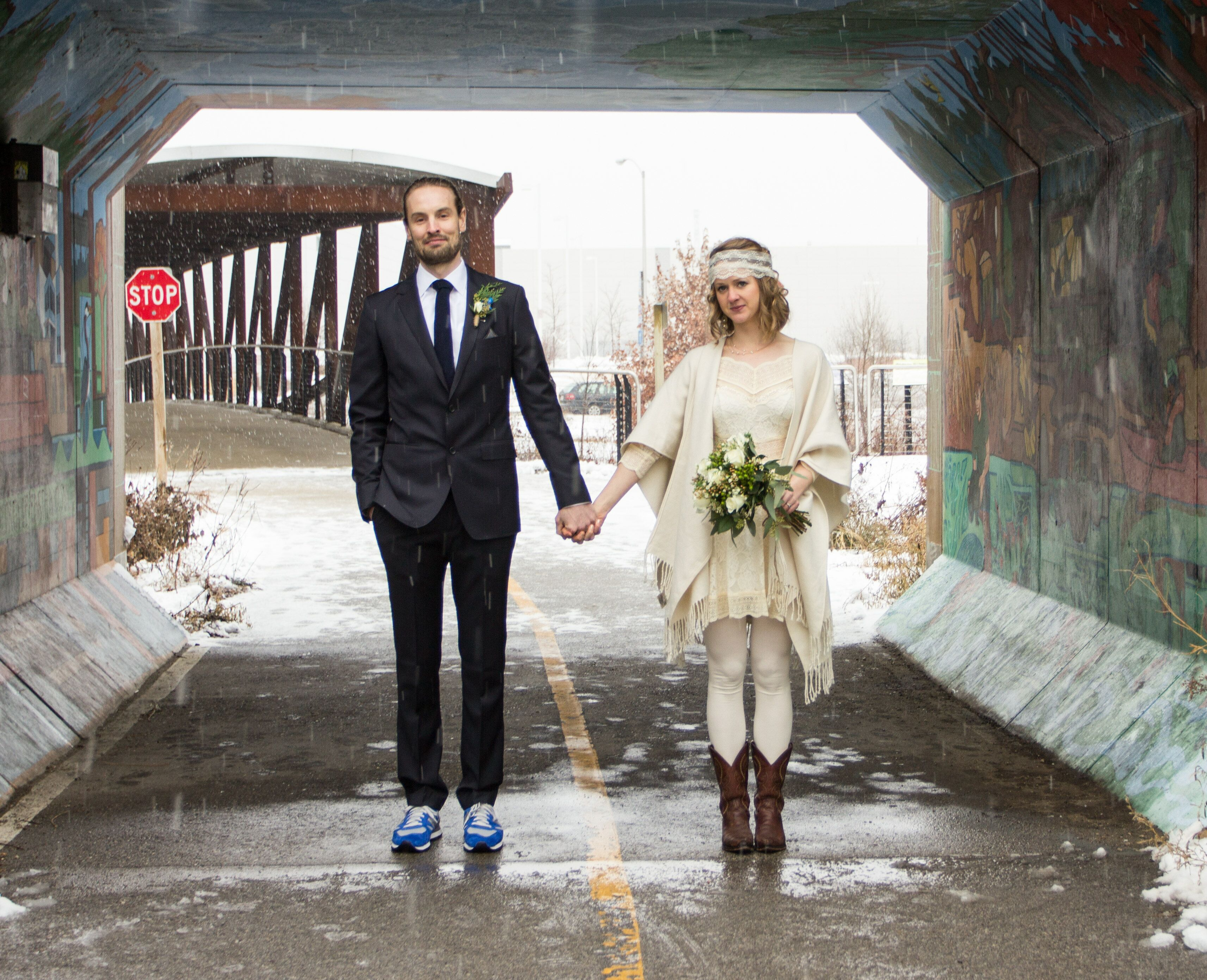 Groom In Suit And Sneakers And Bohemian Bride In Short