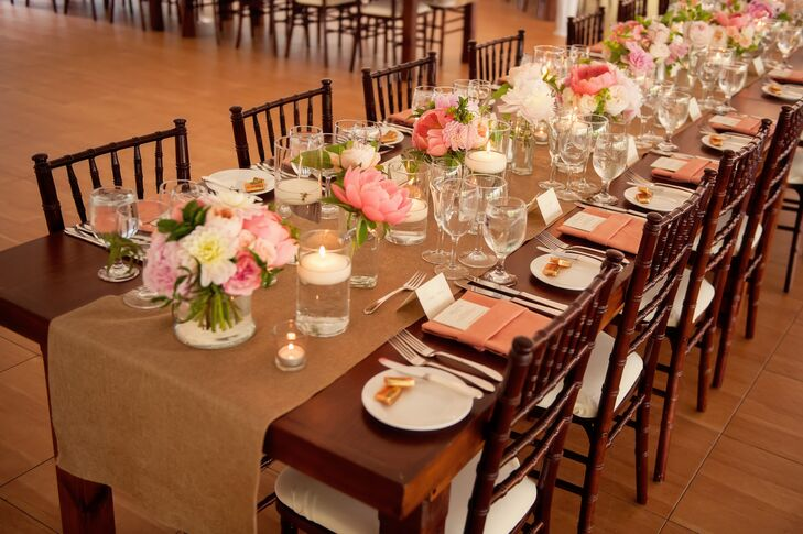 Long, wooden farmhouse tables were topped with burlap runners and lop arrangements of pink peonies and garden roses.