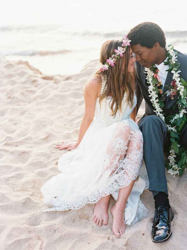 couple sitting on beach in Hawaii