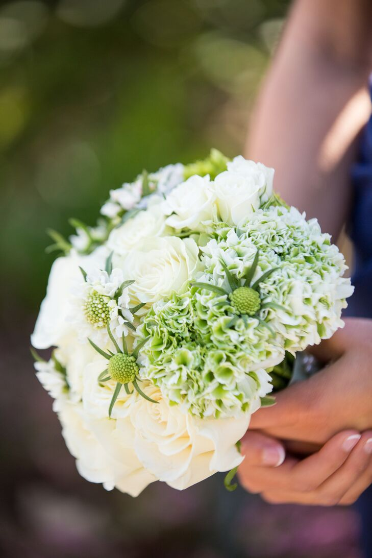 For the bridal party bouquets, they used white  roses, green scabiosa and white and green hydrangeas to contrast the deep blue bridesmaid dresses.