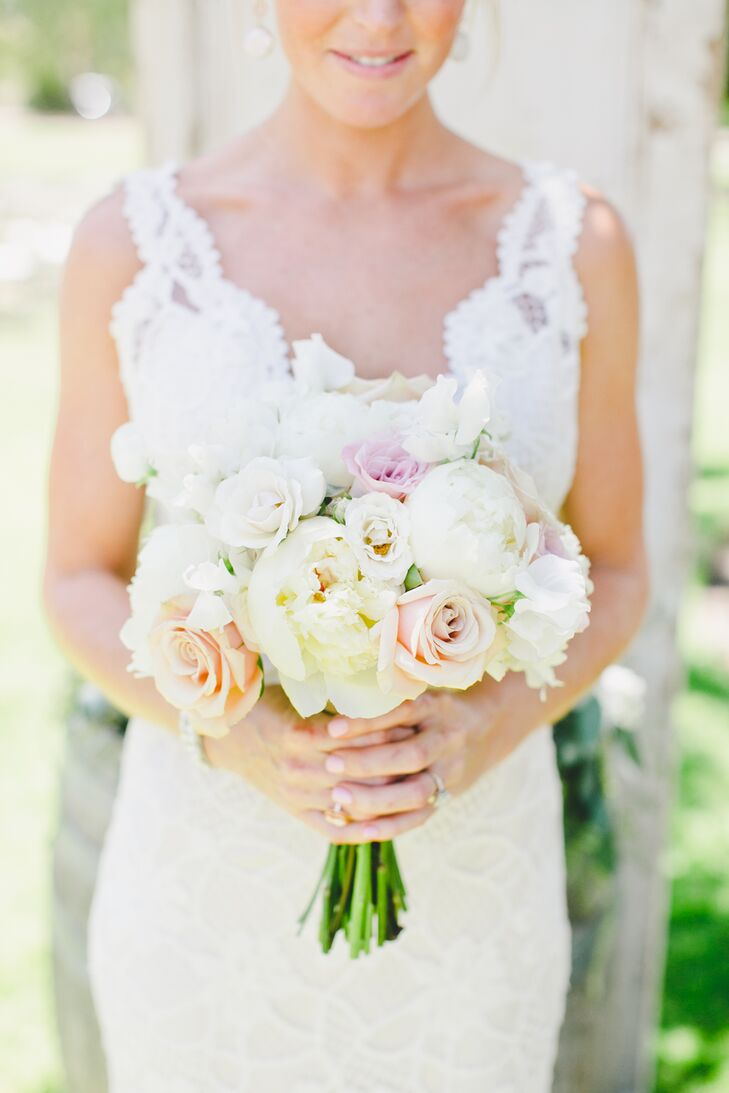 "Victoria held a romantic bouquet filled with pastel-colored roses and peonies, matching the day's soft palette. ""For me, flowers weren't something I had put a lot of thought into,"" Victoria says. ""I knew I wanted to keep the bouquets simple, and thankfully, we have a family friend who put everything together perfectly."""