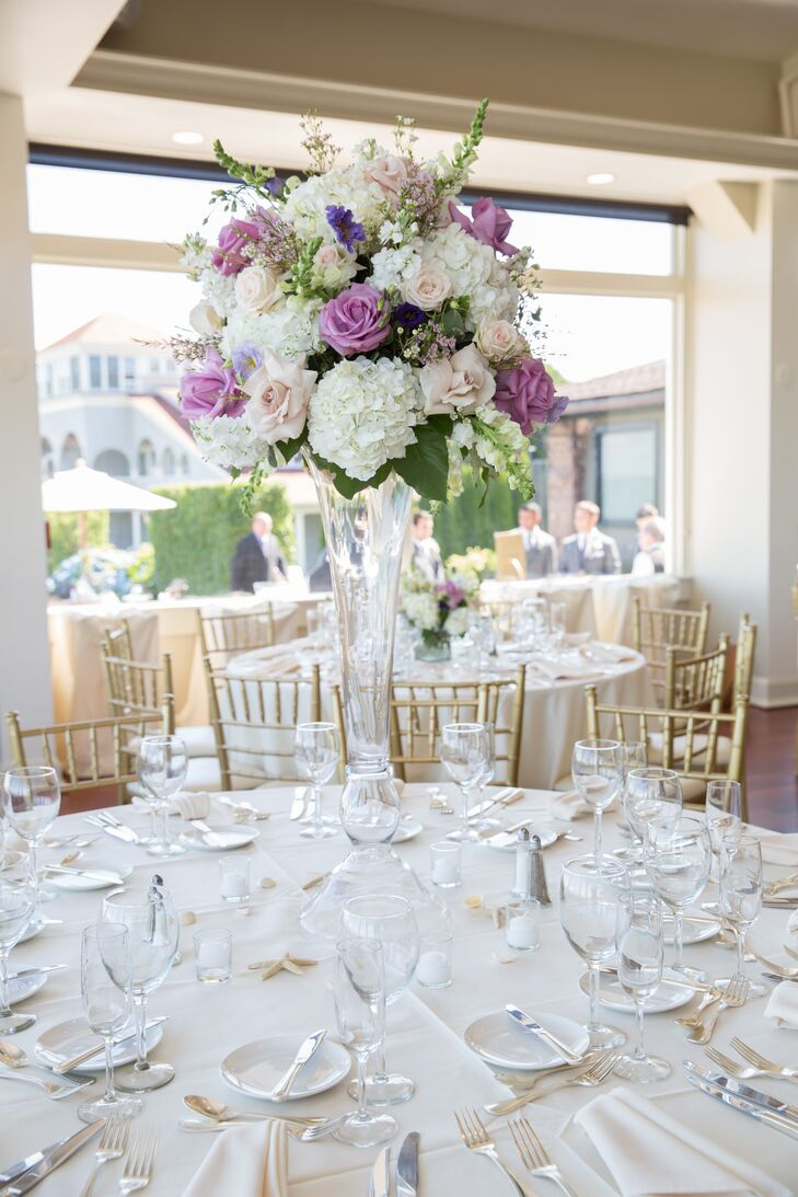 After exchanging vows overlooking the Atlantic, the newlyweds and their guests headed to the Ocean Cliff's elegant ballroom for the reception. Golden Gate Studios brought the room to life with an array of tall and low arrangements of hydrangeas, roses and stock in soft shades of purple and white. Starfish, seashells and votive candles surrounded each centerpiece, adding a nautical touch and warm, ambient glow to the tabletops.