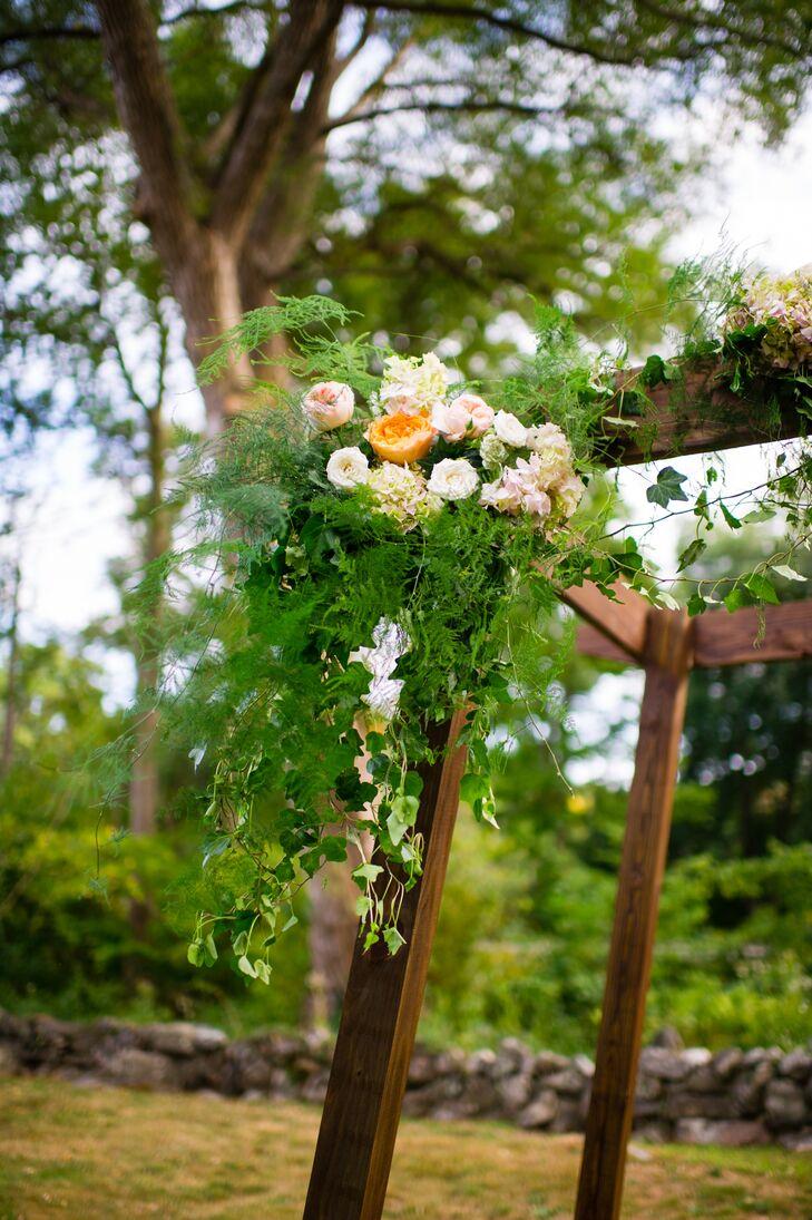 handmade wooden wedding arbor with peach flowers photo wedding arbor