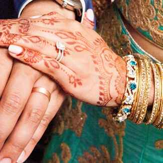 Bride with a diamond engagement ring and groom with wedding ring