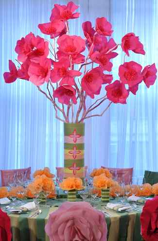 Tall pink paper flower wedding reception centerpiece