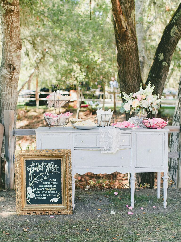 Cute ceremony idea with a DIY petal toss station that guests can put together