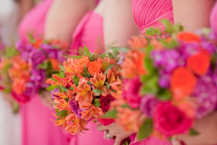 The bridesmaids carried alstroemeria, roses and fern in their bright orange and pink bouquets.