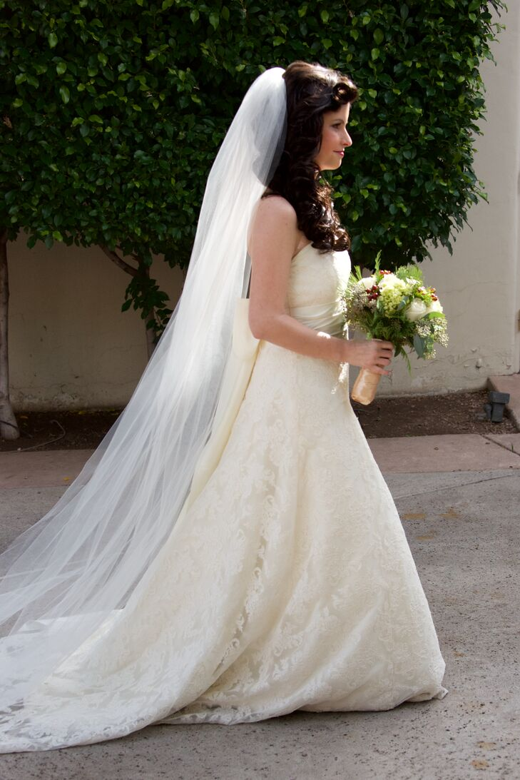 Camelia wore an elegant Jenny Yoo lace wedding dress with a cathedral veil.