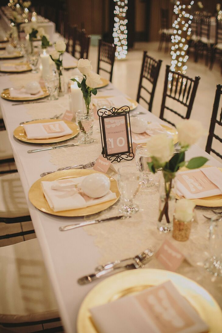 Gold chargers were topped with the couple's maraca favors and set on top of white linens at the reception.