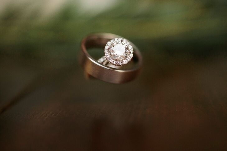 Tom proposed with a brilliant round-cut diamond engagement ring with a halo in a platinum band. Nicole loved how simple and chic the ring was and how it match her classic style.