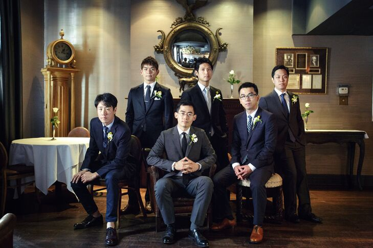 The groomsmen were the picture of perfection in sophisticated matching navy suits. Jong opted for one in a dark gray color to stand out from the rest of the guys.