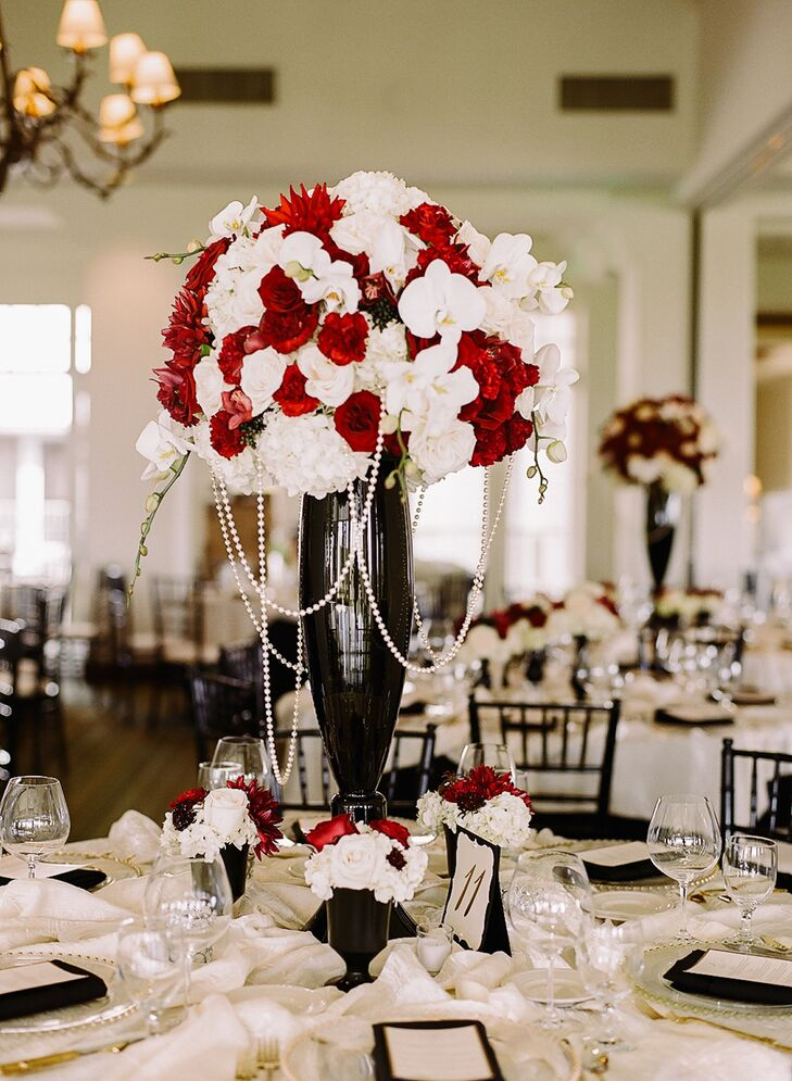 Ivory and red flower centerpiece black vase