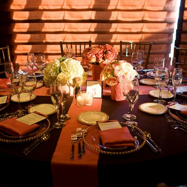 Three vases wrapped in decorative paper and filled with coffee beans and pink and white flowers topped each table. Votive candles helped connect the separate arrangements.