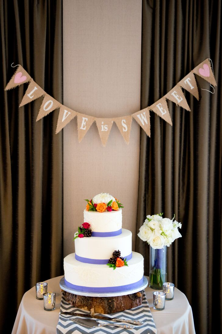 """Our wedding cake was prepared by Shamane's Cakes,"" Michelle says. ""The top two tiers were coconut cream and the bottom layer was a light berry-citrus mix. We can attest that both layers were delicious, as we consumed the leftovers at the end of the reception in our room."""