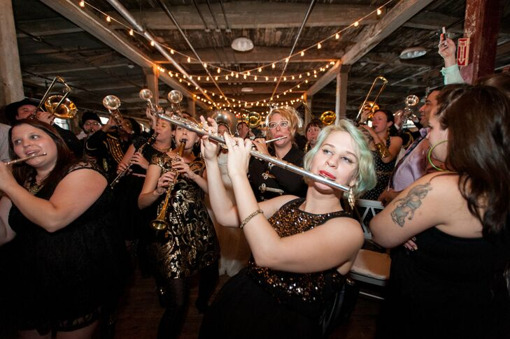 "Since Diana and Thomas met through the Detroit Party Marching Band, they recruited the group for their wedding reception. In addition, the couple invited 25 musically inclined guests to join them in their wedding entrance. ""Obviously Thomas and I weren't just going to sit there and watch,"" Diana says. ""When they announced us, we came in with the band and played the whole set with them—me with my trumpet and Thomas playing the tuba in his tux."""