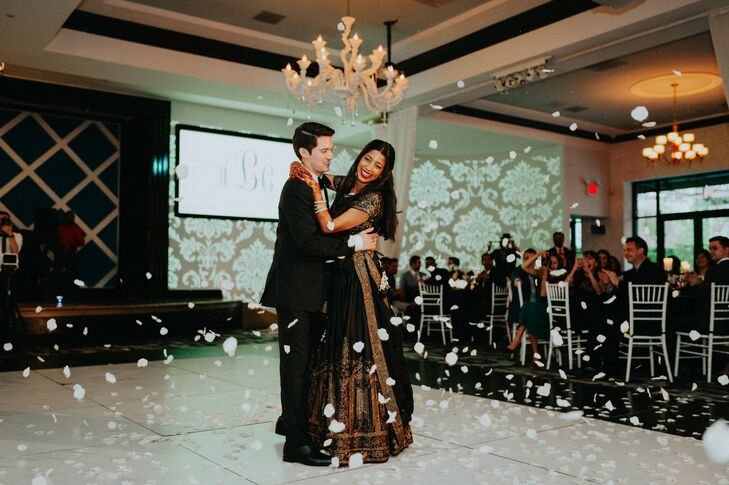 For the reception at Vie in Philadelphia, Pennsylvania, the couple changed into formal attire that mirrored the evening's glamorous black and gold theme. Christophe donned a classic black J.Crew tuxedo, while Anjali opted for a custom black and gold panetar.
