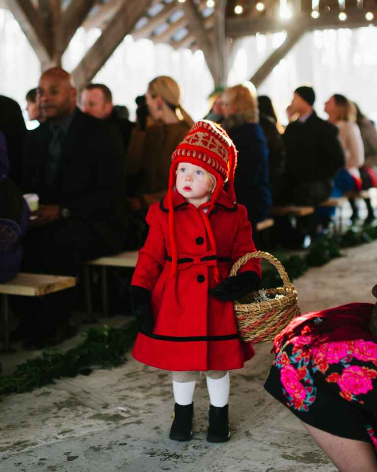 Flower girl dressed in cute winter clothes