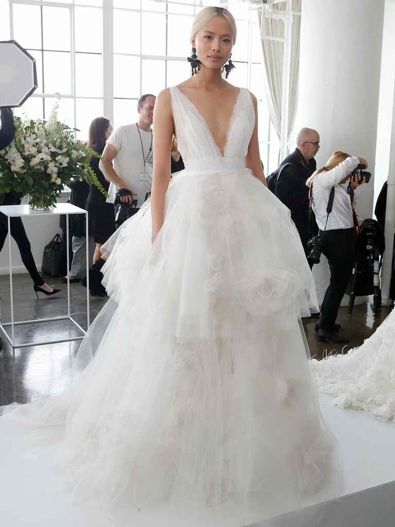 Marchesa Spring 2018 wedding gown with tulle layers and plunging neckline