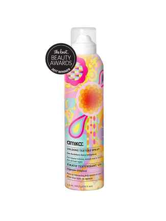 The Knot pick for best texturizer is the Amika Un.Done texture spray