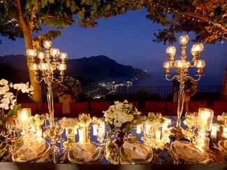 Outdoor wedding reception with candlelight