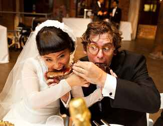 Bride and groom share barbecue ribs