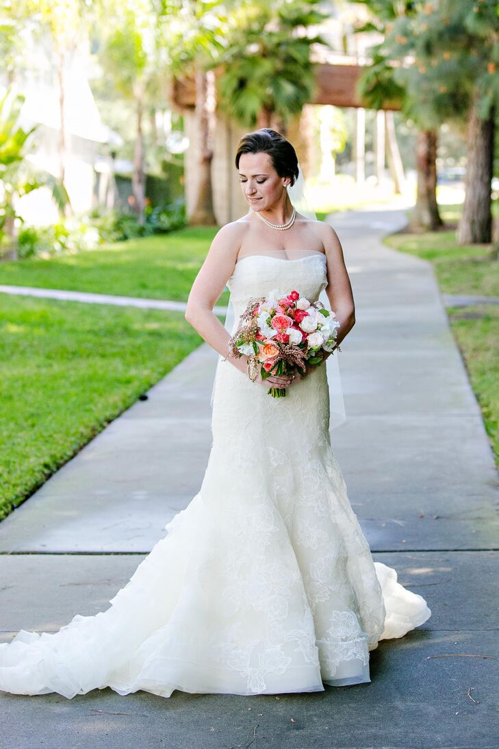 """I wore Vera Wang's Leda gown, which I tried it on at my very first appointment and immediately feel in love,"" says Suzanne. ""She embodied every element I wanted in a dress - elegant, sexy, fun, timeless. Gorgeous tulip and rose lace sitting atop layers of web lace and horsehair bands creates texture, volume and movement that I could find in no other dress."""