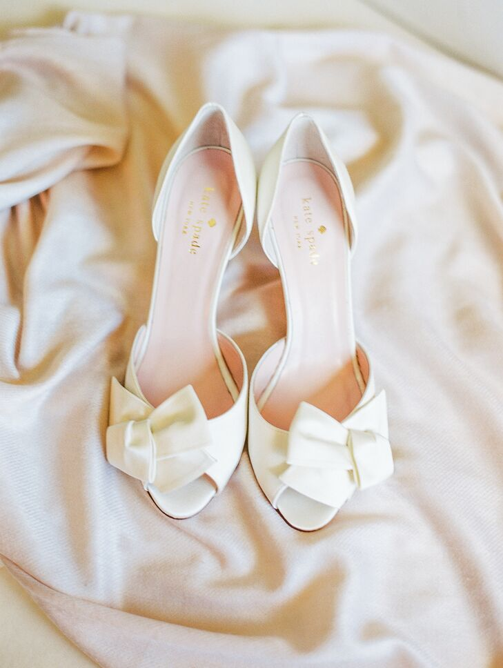Andrea accessorized her classic ball gown with ivory satin Kate Spade shoes with sparkly heels.