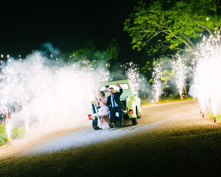 "After Paige and Matt's sparkler exit, they hopped onto the back of their friend's vintage truck and headed down the road. As they approached the exit of Pecan Springs Ranch in Austin, Texas, they got an unexpected treat: fireworks. ""We were completely surprised and in awe,"" Paige says. ""It was the perfect ending to a perfect night."""
