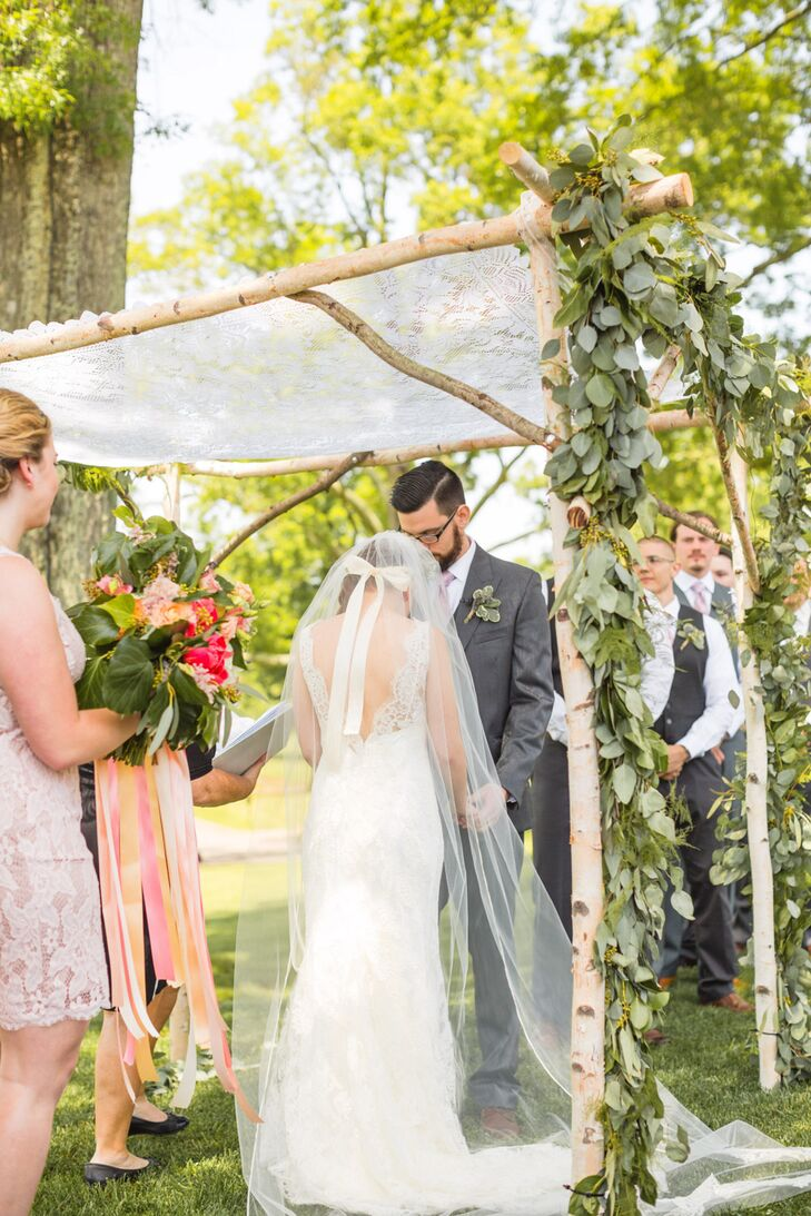 Garrett and his father built the birch-tree huppah under which the couple exchanged vows. It was adorned with greenery garland and topped with a delicate fabric.