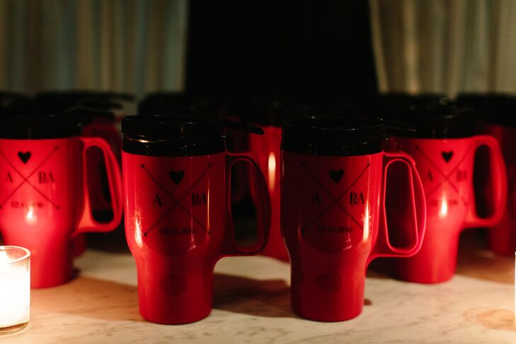 """We wanted wedding favors that would be useful beyond just our wedding day,"" Allison says of the red travel mugs printed with their custom wedding logo. To send guests off at the end of the night, a hot cocoa station was set up with steaming hot chocolate and homemade marshmallows."