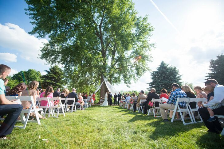"""We had our wedding at Mustard Seed Gardens in Noblesville, Indiana,"" Renee says. ""We chose this location because it is absolutely beautiful. The outdoor ceremony area is serene and simple, while the reception completely fit in with Nathan's barn-loving heart, and I happened to love it too."""