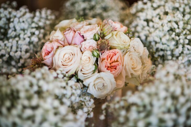 Lori's bouquet was a soft mix of pastel garden roses.