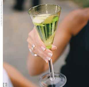 green cocktail in a champagne flute