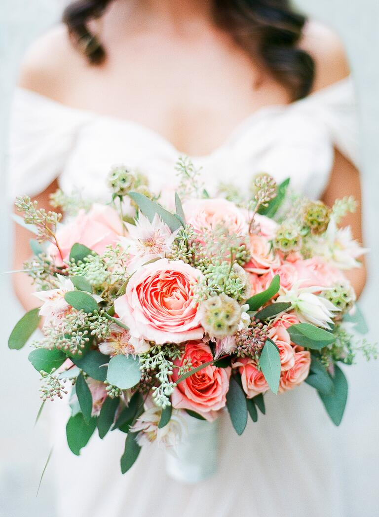 Matthew David blush and pastel green bridal bouquet with roses, bridal veil potea, scabiosa pods, and eucalyptus