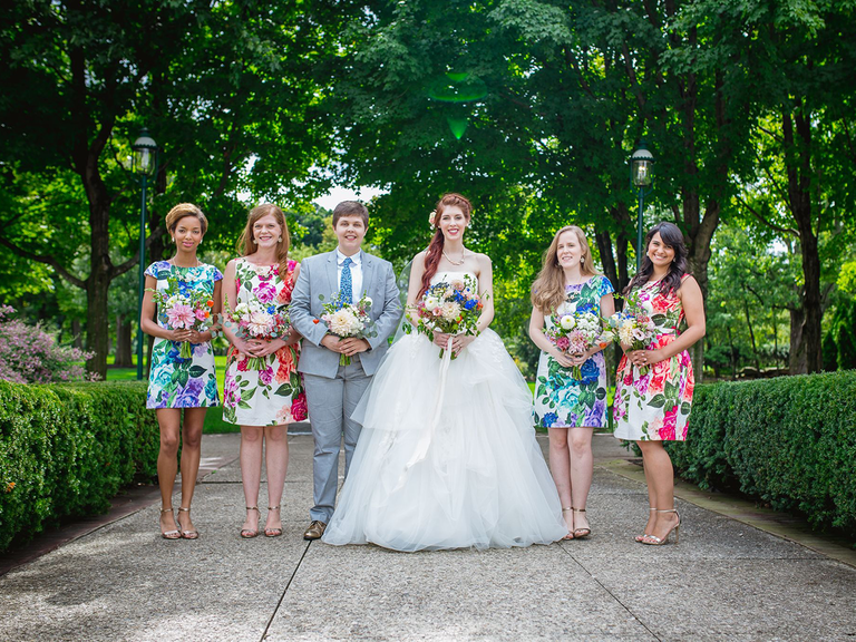 Bride with bridal party in floral bridesmaid dresses