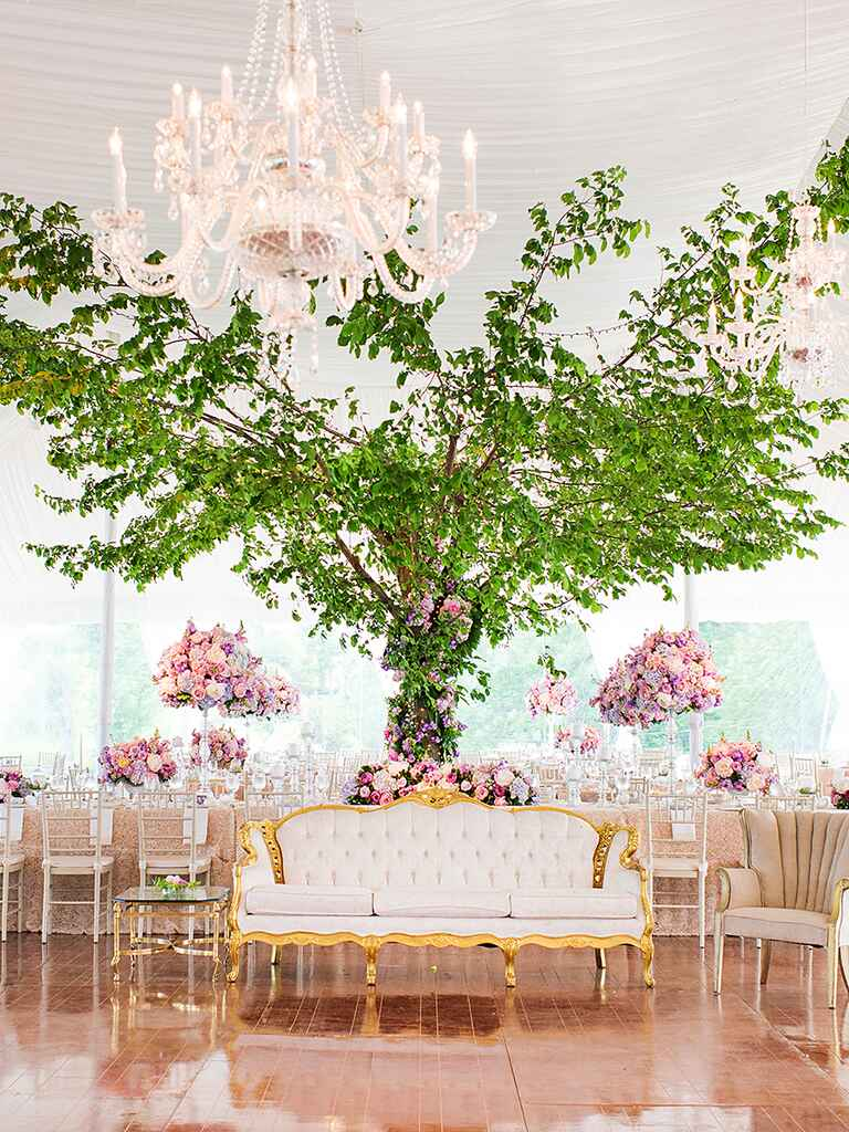 Outdoor tented wedding reception with a romantic lounge area