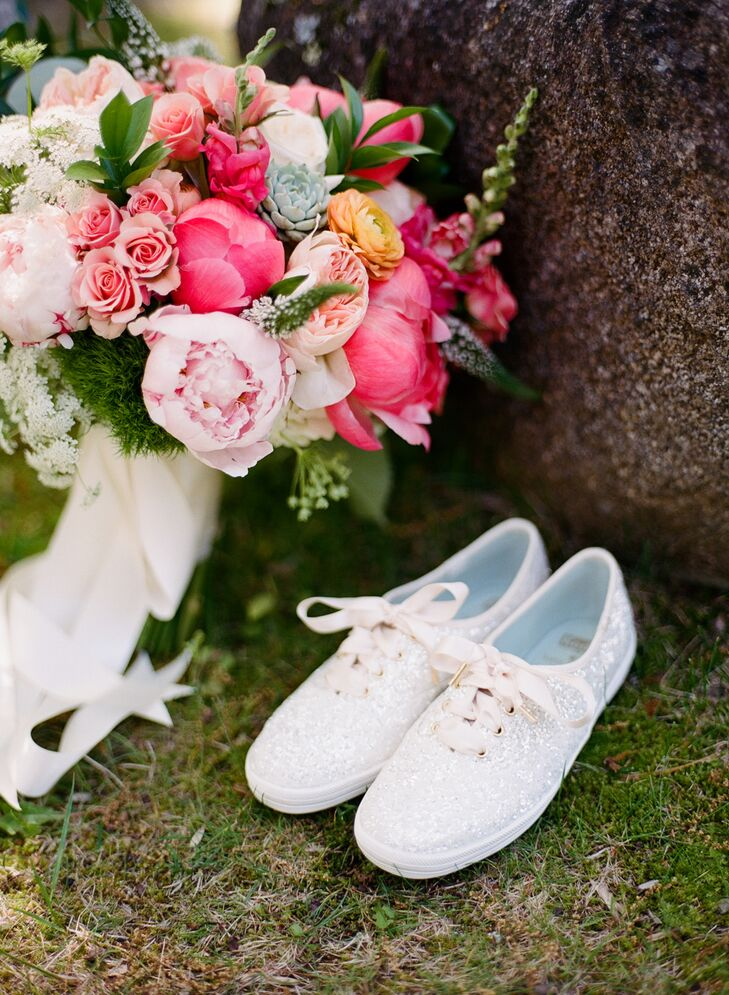 "During the ceremony, Jamie accessorized her Romona Keveza gown with a pair of Badgley Mischka shoes, then switched into a pair of white glittery Kate Spade Keds for the reception. ""I am the biggest Kate Spade fan, so I had to make sure to incorporate her some how,"" Jamie says."