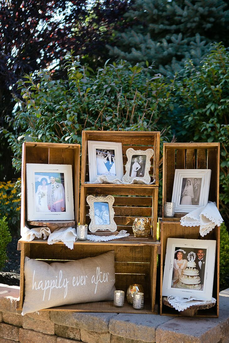 Using old wine crates, Mary was able to create a display shelf of family members' wedding photos.