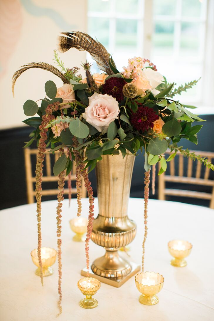 Feather and loose floral arrangement centerpieces