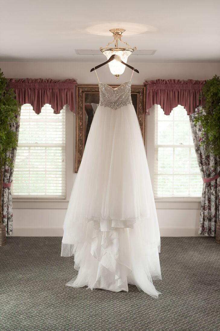With the help of her bridal consultant sister, Aurielle chose a Maggie Sottero dress called Esme complete with a flowing tulle skirt and Swarovski crystal-covered bodice.