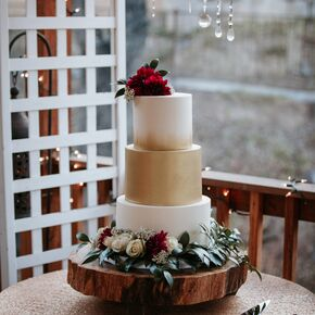 Gold And Ivory Wedding Cake With Crimson Flowers