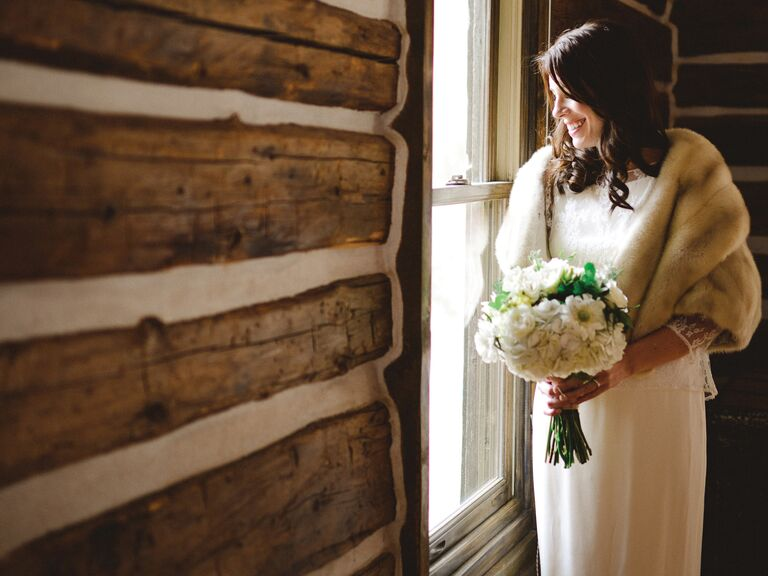 Winter bridal portrait in log cabin