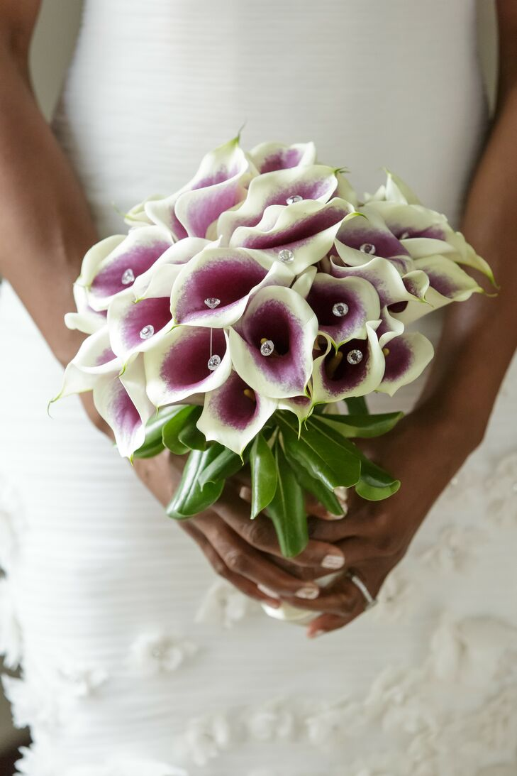 "As purple is her favorite color, Deirdre carried a bouquet of purple and white calla lilies down the aisle. ""I didn't want to look at my pictures 20 years from now and wonder why my sleeves were so puffy or why my hair was so big,"" says Deirdre. ""So, I chose things I liked but was careful to keep that fact in mind."""
