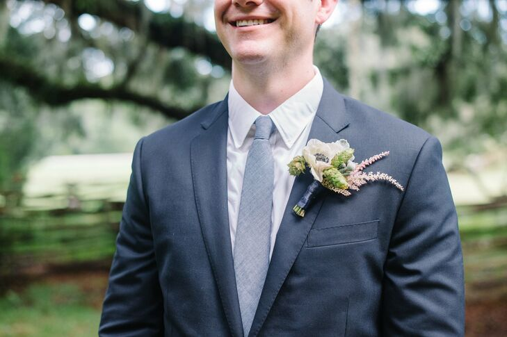 Richard added a rustic boutonniere of anemones, astilbe and hops to the lapel of his classic navy suit.