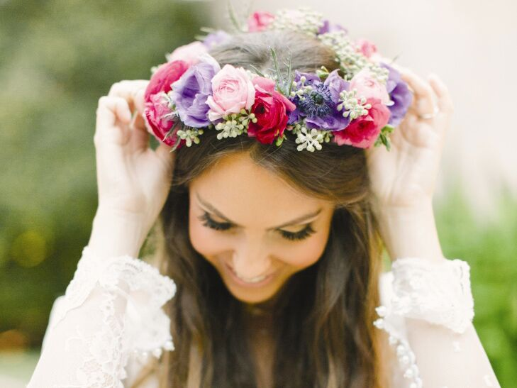 Bride wearing a purple and pink flower crown made of anemones and roses