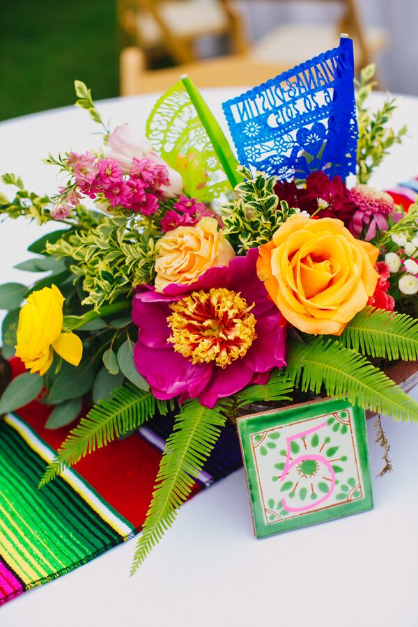Bright Floral Centerpiece With Mexican Tile Table Numbers