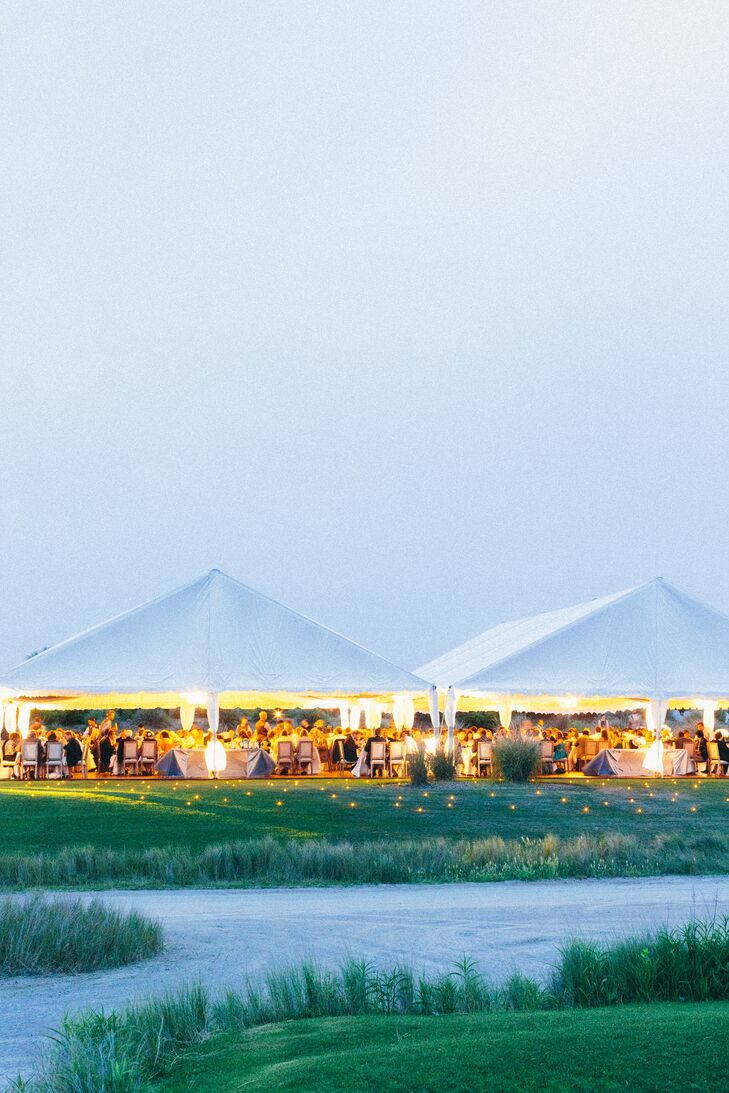 """Our reception tent was actually a combination of four tents spread throughout the grand lawn at the ocean course,"" Nicole says."