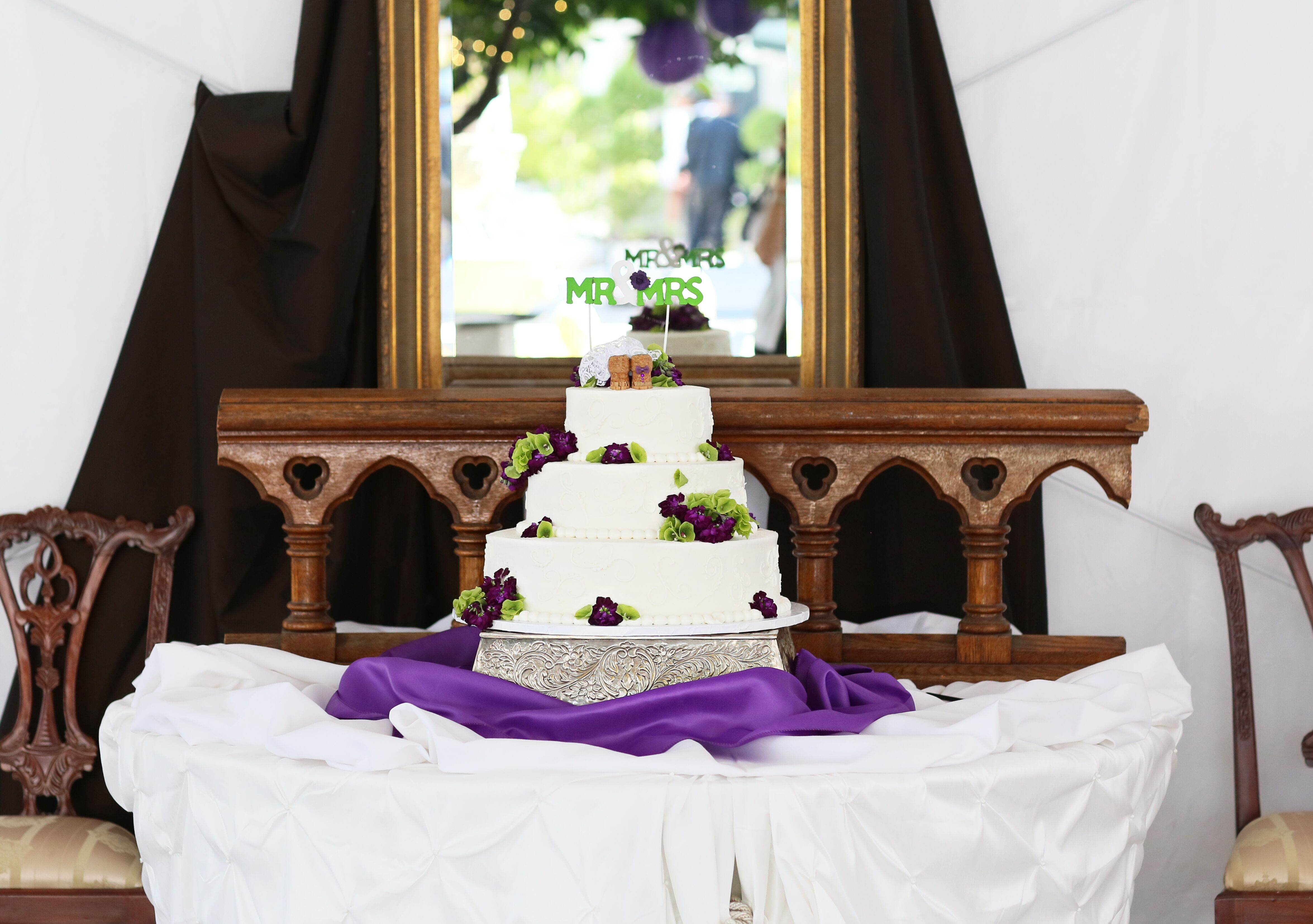 wedding cakes with purple accents ivory wedding cake with green topper 26088